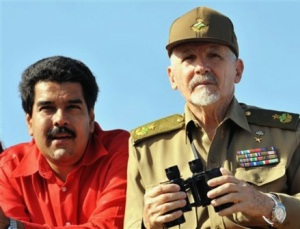 Man in charge, with Maduro to his right