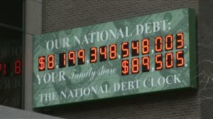 stock-footage-new-york-ny-circa-march-the-national-debt-counter-displays-how-much-money-america-owes-and