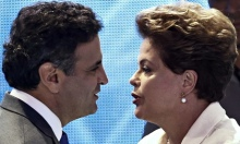 Aécio Neves, the Social Democrats' candidate, greets Dilma Rousseff, of the Workers' party, before a