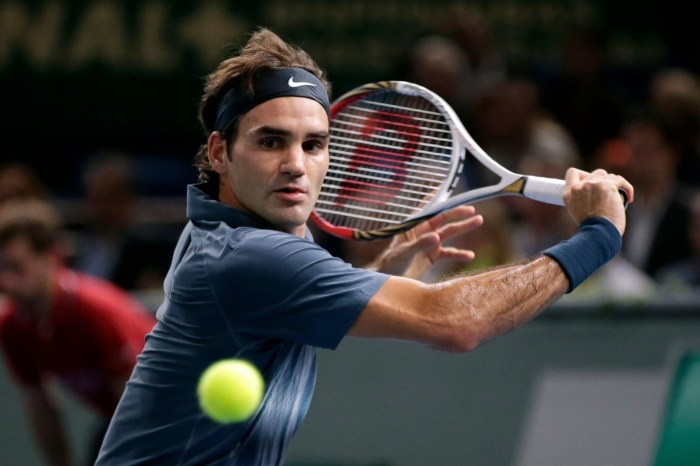 Federer of Switzerland hits return to Djokovic of Serbia in their semi-final match of the Paris Masters tennis tournament in Paris